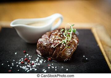 Filet mignon meal - Filet mignon served on a stone board in...