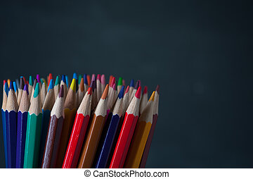 Colorful pencils background with copyspace. Multicolored...