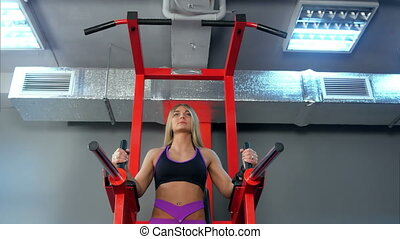 Beautiful woman working out in the gym. Bottom view....