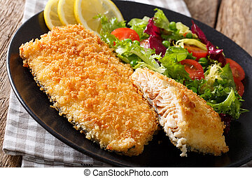 Fried fish fillet in breading and fresh vegetable salad...