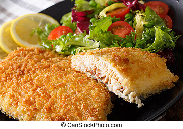 Fish fillet of Arctic char in breadcrumbs and fresh salad...