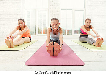 Three happy women during stretching - Being flexible. Nice...