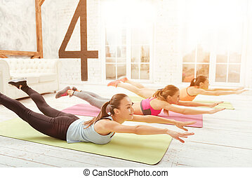 Youthful women lying on floor and stretching - Creating...