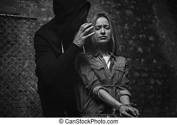 Dreaded cunning abductor threatening a woman - Making you...