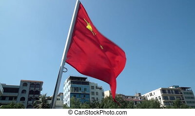 Chinese flag waving in the wind in slow motion
