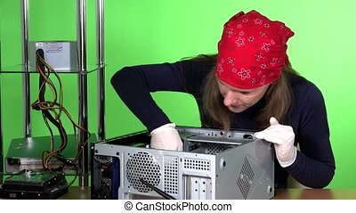 Female computer specialist removing ram memory from desktop...