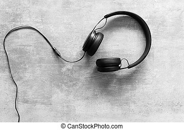 Headset on a concrete background - Black headset on a...