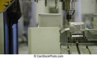 A CNC milling machine milling heads in metal industry HD