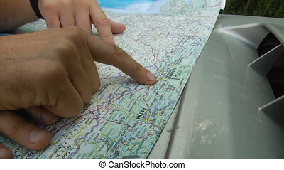 Close-up of the map and hands on it