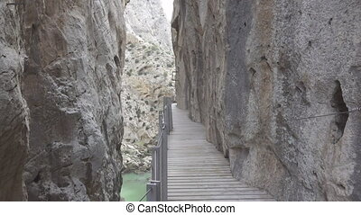 Walking on 'El Caminito del Rey' - A tourist walks in El...