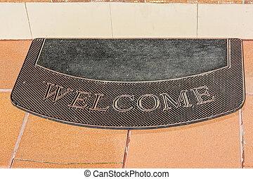 Brown welcome doormat close up