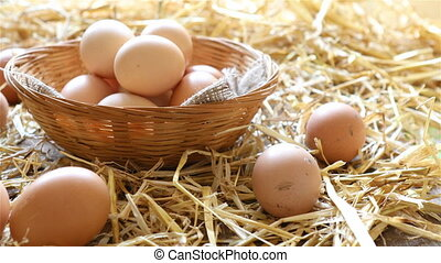 Fresh organic eggs in a basket - Basket of organic eggs in a...