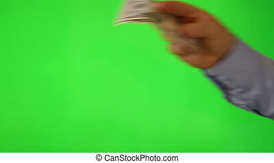two takes of hand giving away money over green screen