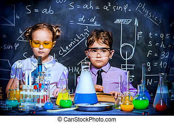 young scientists in a lab - Two little children scientists...