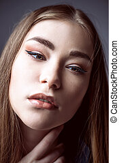 eyeliner arrows - Beauty concept. Young woman with long...