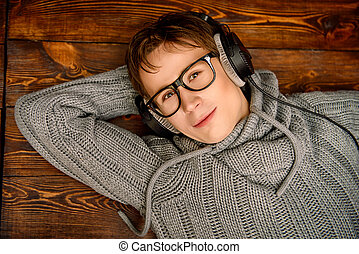 relaxing with music - Happy young man listens to music in...