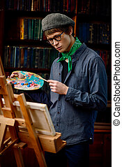 inspired artist - Inspired artist man draws a picture in the...