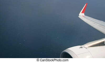 Aerial Passenger Perspective of Open Ocean with Airplane...