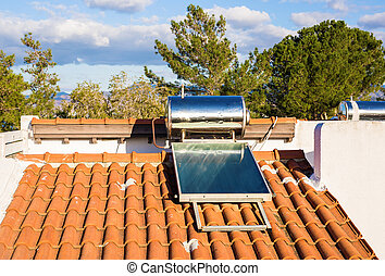 Domestic solar panel on a roof, with clear, cloudless sky.