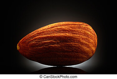 Almond on black background. Close-up or macro - Almond on...