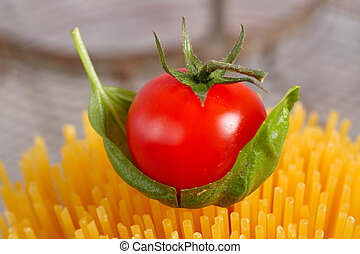 Close-up of a cherry tomato on pasta