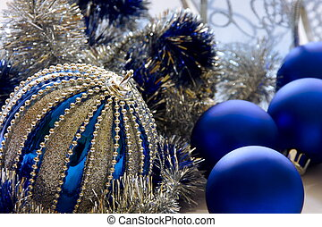 Blue Christmas balls with silver tinsel.
