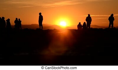 People waiting for the sundown - Group of people waiting for...