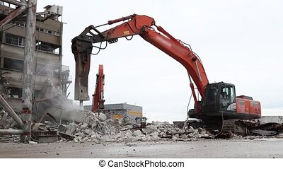 Tracked Excavator with demolition hammer - construction site...