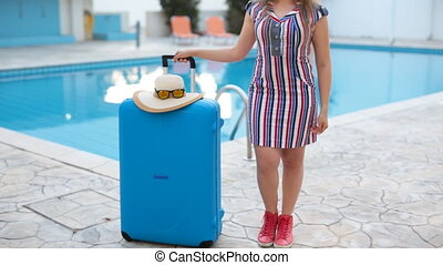 Happy young woman arriving to the resort. Travel concept