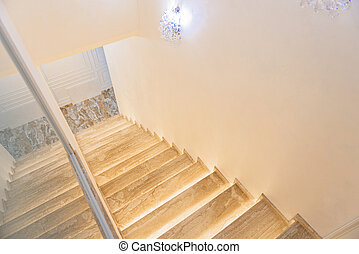 Interior of little hall with wooden staircase - Light small...