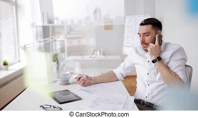 businessman with papers and smartphone at office - business,...