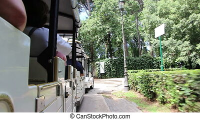 Touring Villa Borghese in a small open train - Shot of...
