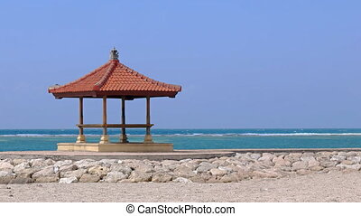 Pagoda Stands over Calm Waters of a Balinese Tropical Beach...