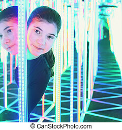 girl in mirror maze try to find way out - Teenage pretty...