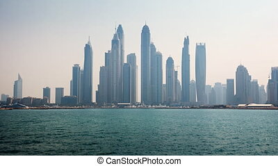 Timelapse Abstract of the Dubai Skyline over the Harbor -...