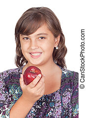 Adorable preteen girl with a apple isolated on white...