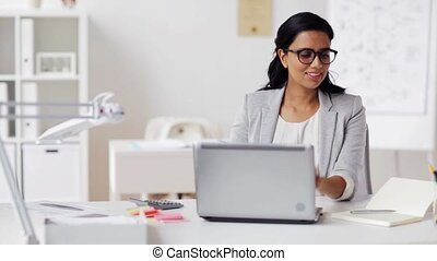 businesswoman with laptop and notebook at office - business,...