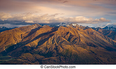 Landscape view of mountain range at sunrise, Wanaka Lake, NZ...