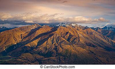 Landscape view of mountain range at sunrise, Wanaka Lake, NZ...