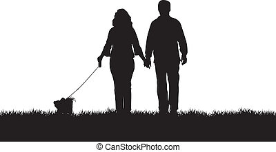 dog walking - a couple walking their dog