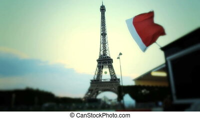 The French flag And The Eiffel Tower In Paris - Shot of The...