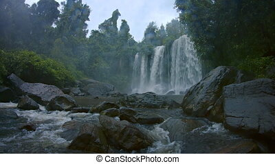 River Water Tumbles over Cambodian Waterfall, with Sound -...