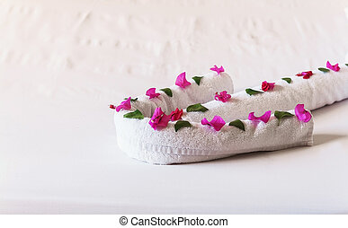 of white towels twisted arrows with flowersl.