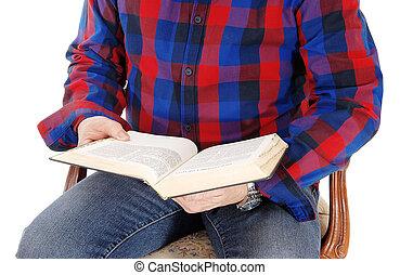 Closeup senior man studding the bible.