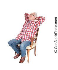 Senior man relaxing on chair. - An senior citizen man in a...
