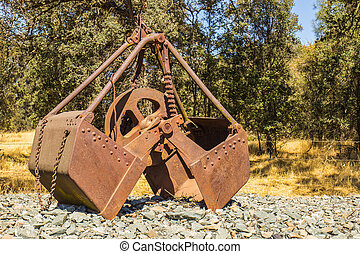 Vintage Scoop Bucket Used in Past Mining Operations