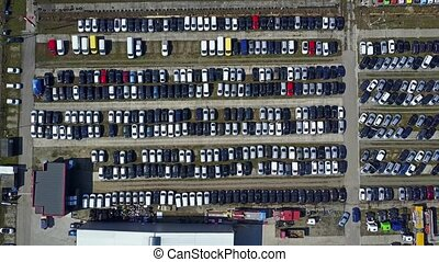 Aerial shot of new cars and trucks parking, top view. 4K...