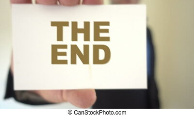 The end title held by businessman - Shot of The end title...