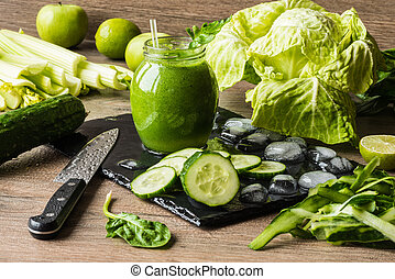 Detox diet. Green smoothie with different vegetables on...