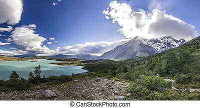 mountains of patagonia at sunset near blue lake from...